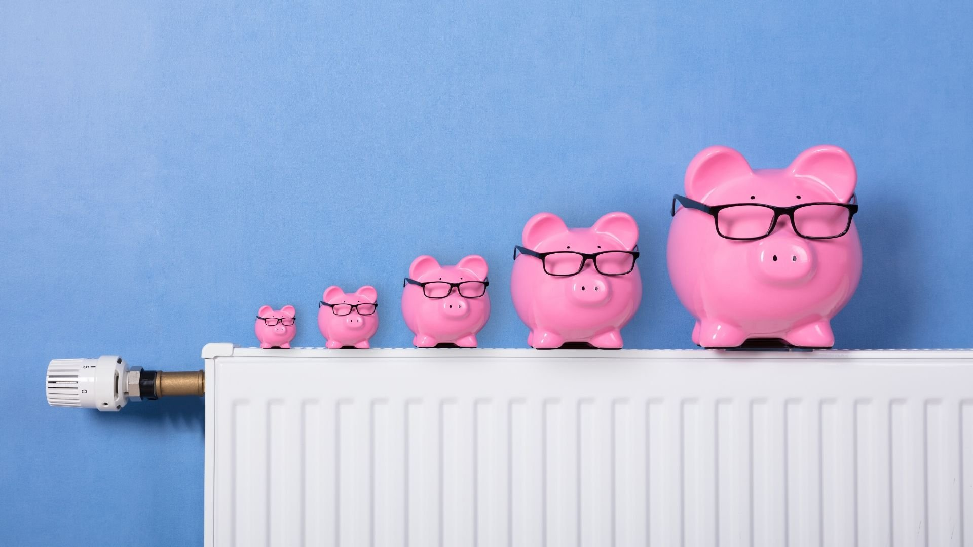 5 piggy banks on top of a radiator