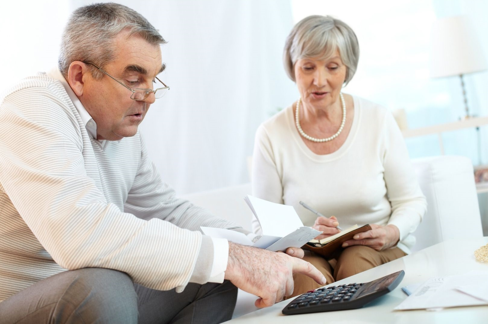 older couple working out their finances