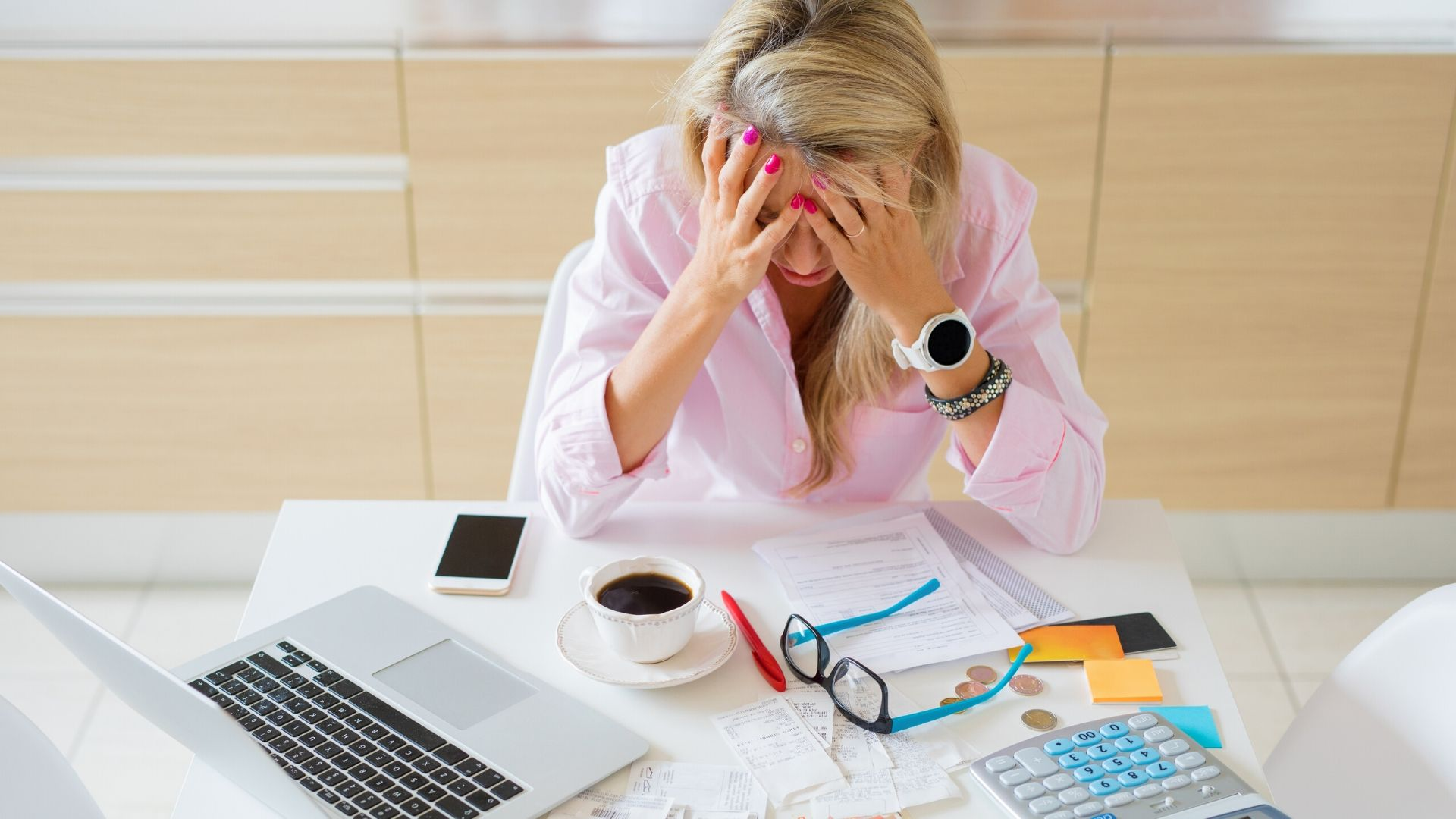 woman sitting at her desk surrounded by financial paperwork with head in hands. Independent Financial Adviser, Independent Financial Planners, Financial Planning, Personal Financial Planning, Personal Finances, Pensions, Retirement Planning, Tax Planning, Cash Flow Budgeting, Banking, Insurance, Mortgages, Savings, Investments, Estate Planning, Later Life Forecasting, Investment Portfolio, Financial Guidance, Financial Advice, Financial Security, Family Protection, Tax Efficient Investments, Saving For Long Term Goals, Life Centred Financial Planning, Life Centred Financial Advice, Life Centred Financial Planners, Life Centred Adviser, Life Centred Advisor, Lifestyle Financial Advisor, Lifestyle Financial Adviser, Lifestyle Financial Planners, Lifestyle Financial Planning
