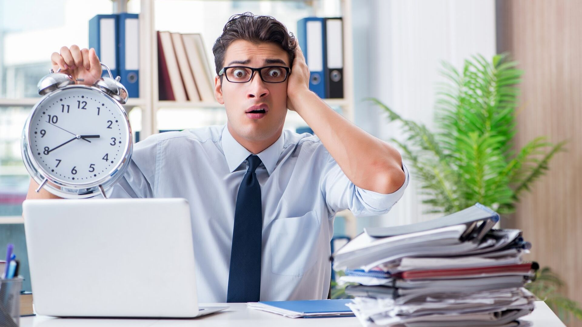 Business person looking worried at missing the deadline