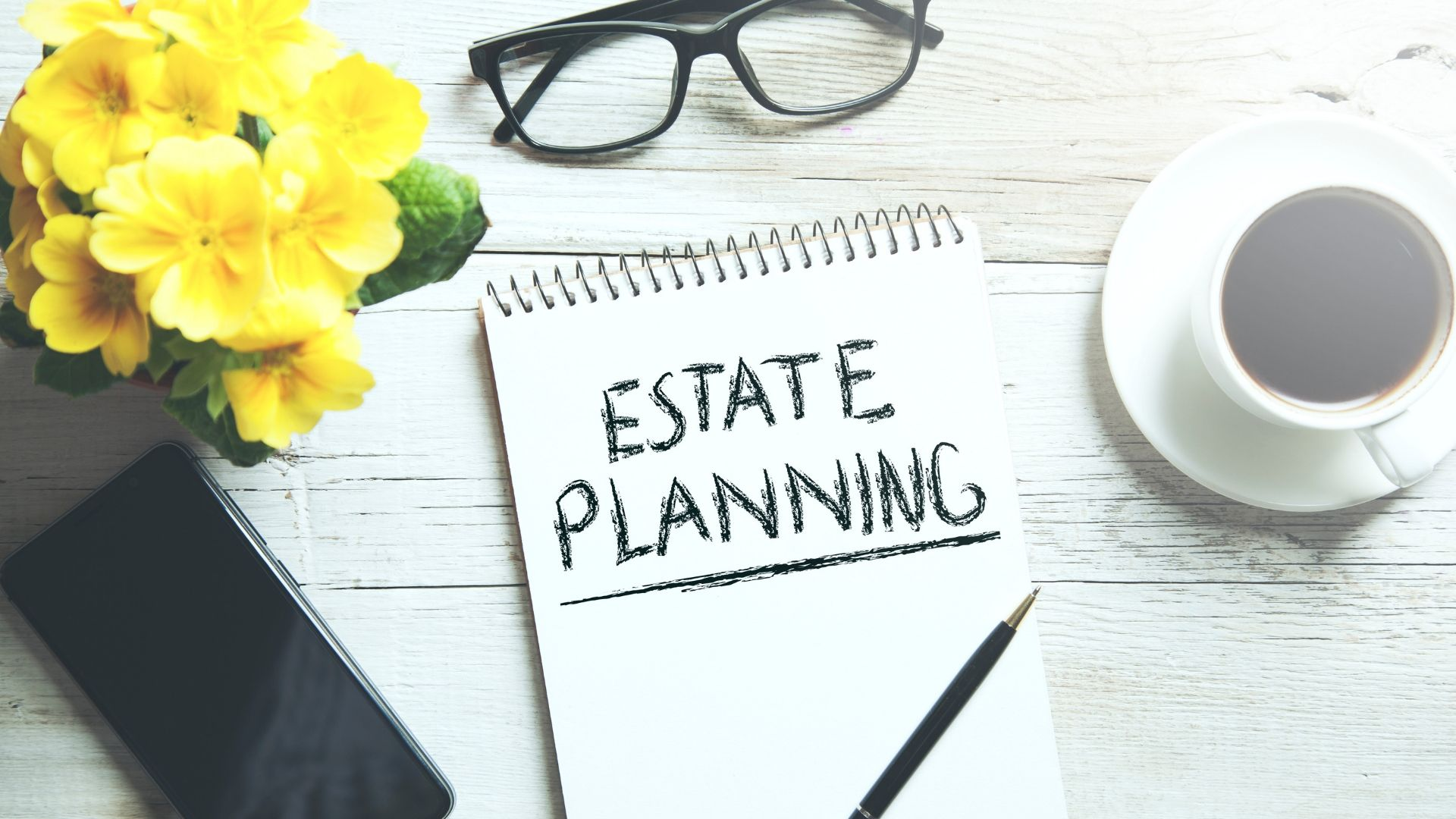 Image of a note pad with the words 'estate planning' written on. Have you thought about inheritance tax planning and the residence nil rate band?