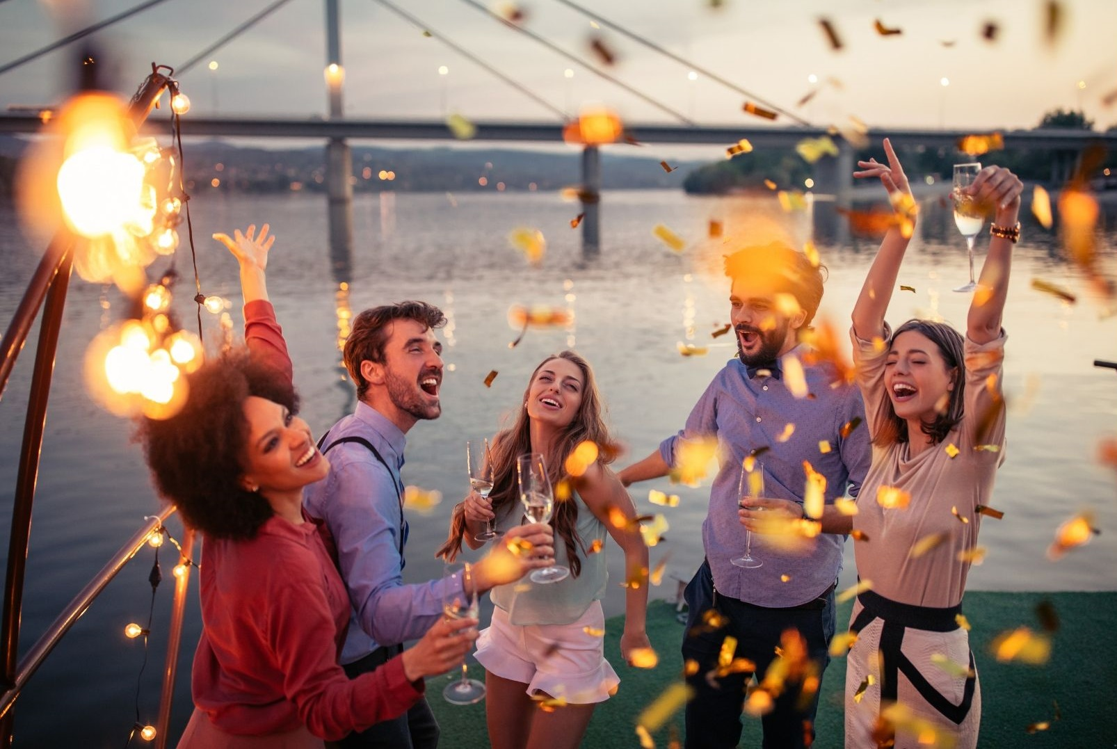 group of friends celebrating on a boat