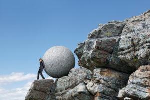 Women-pushing-boulder-uphill-e1503588501845.jpg